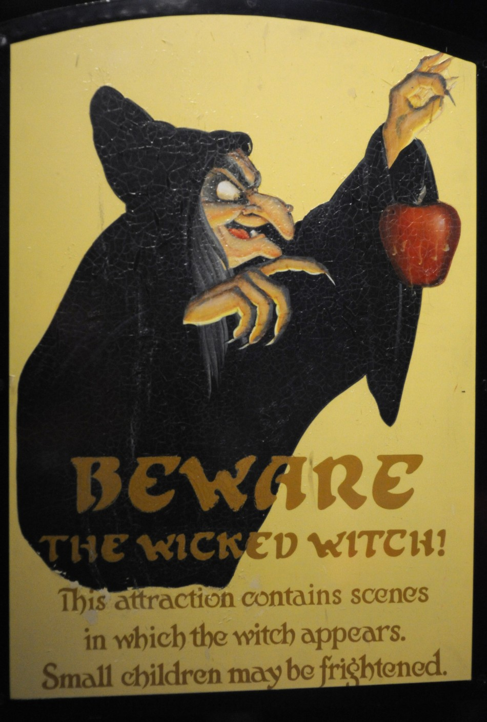 "An attraction sign from ""Snow White's Scary Adventures"" is displayed at the D23 Presents Treasures of the Walt Disney Archives exhibit in California"