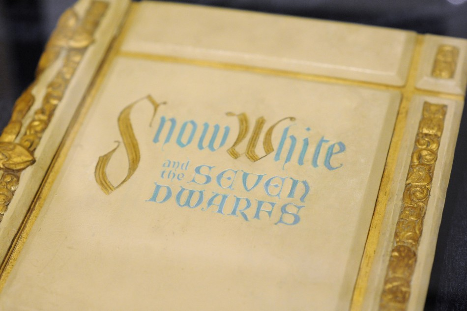 "A storybook used in the 1937 film ""Snow White and the Seven Dwarfs"" is displayed at the D23 Presents Treasures of the Walt Disney Archives exhibit in California"