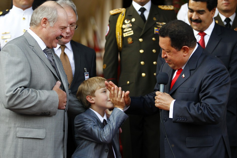 Nikolai Lukashenko flanked by his father and Venezuela's Hugo Chavez