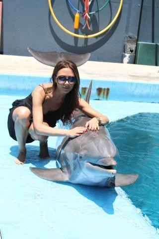 Victoria Beckham with dolphins