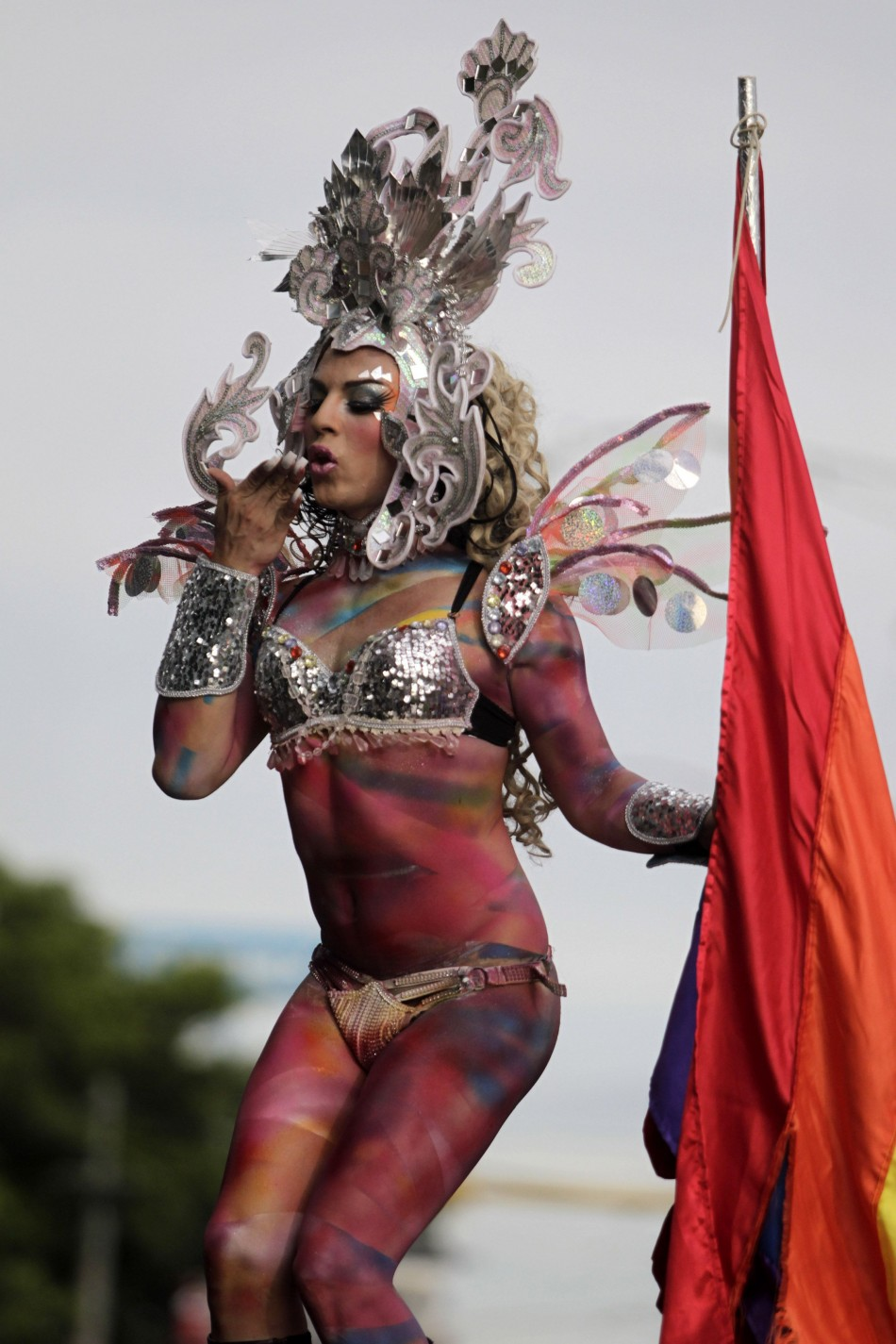 A member of the LGBT community takes part in a gay pride parade in Managua, capital of Nicaragua