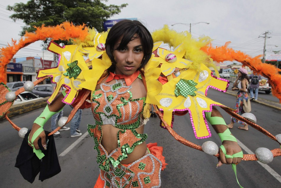 A member of the LGBT community takes part in a gay pride parade in Managua