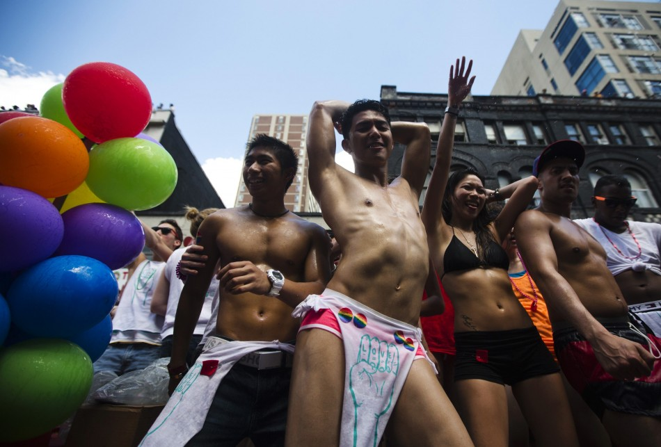 People dance during the Gay Pride parade in Toronto