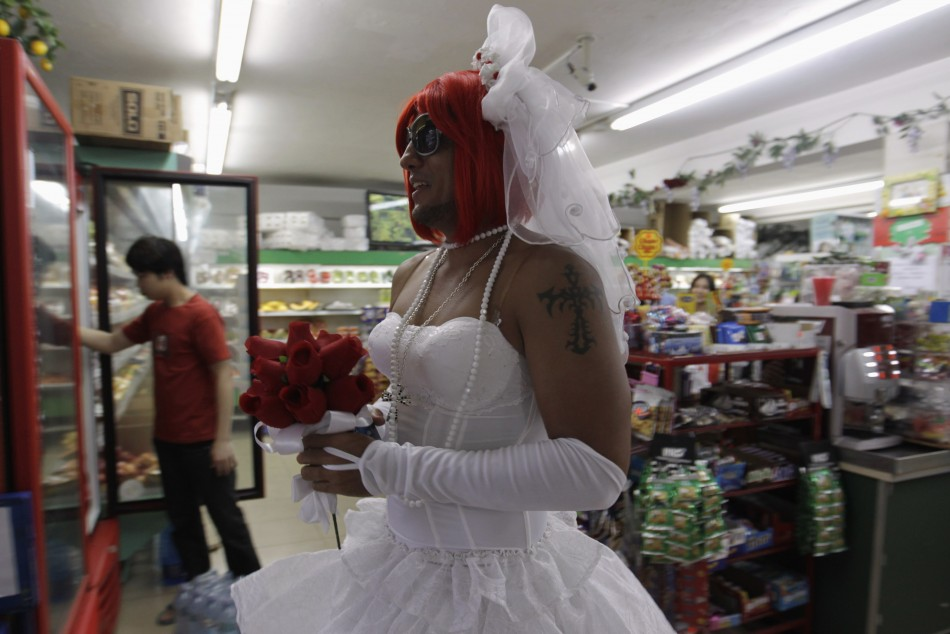 A reveller dressed in a bride costume is seen in a shop during the Gay Pride parade in Panama City