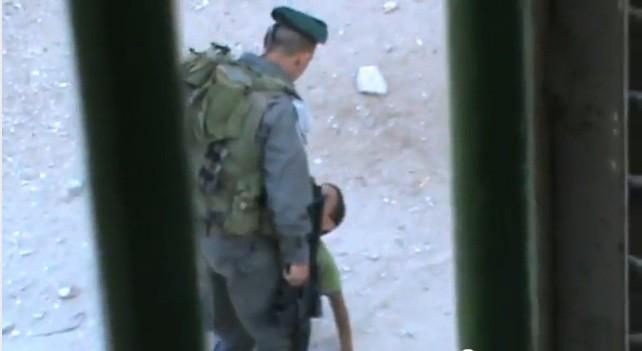 Israeli border police officer kicks Palestinian child Abd a-Rahman Burqan