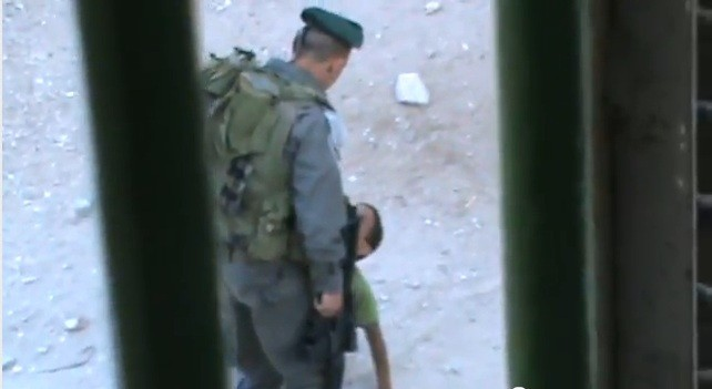 Israeli border police officer kicks Palestinian child Abd a-Rahman Burqan