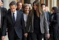 Police searched the home and offices of former French president Nicolas Sarkozy and his wife Carla Bruni's