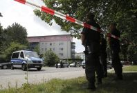 Police surround the siege flat in Karlsruhe, Germany