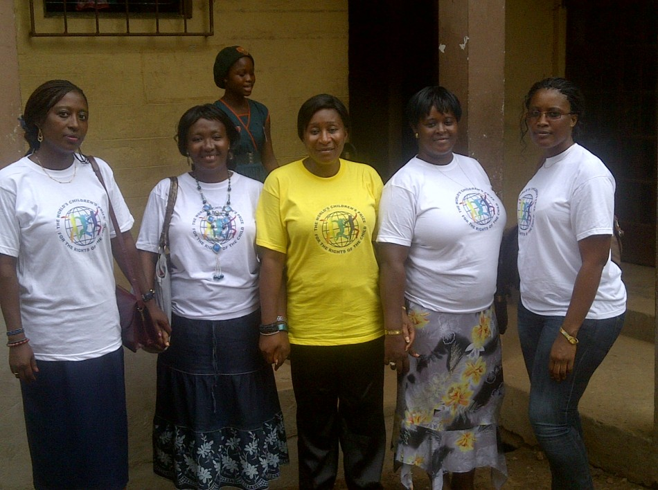 Anita Koroma, Director of Girl Child Network Sierra Leone (C) and some of her staff