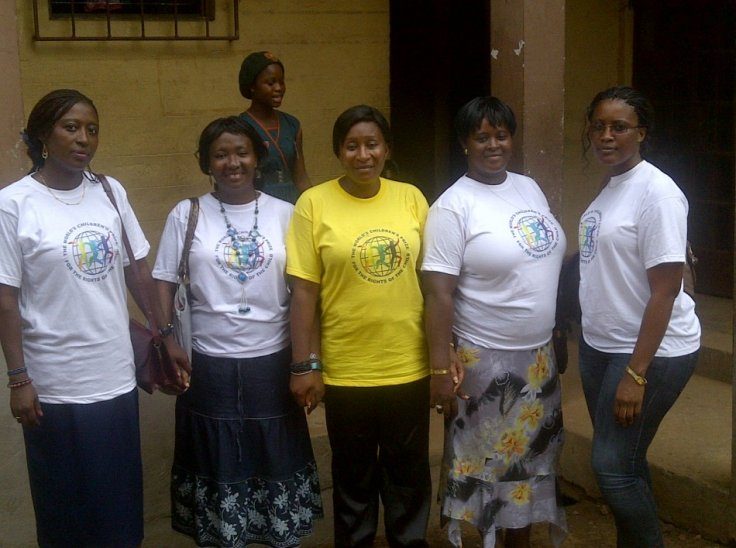 Anita Koroma, country director for Girl Child Network Sierra Leone, with members of her team