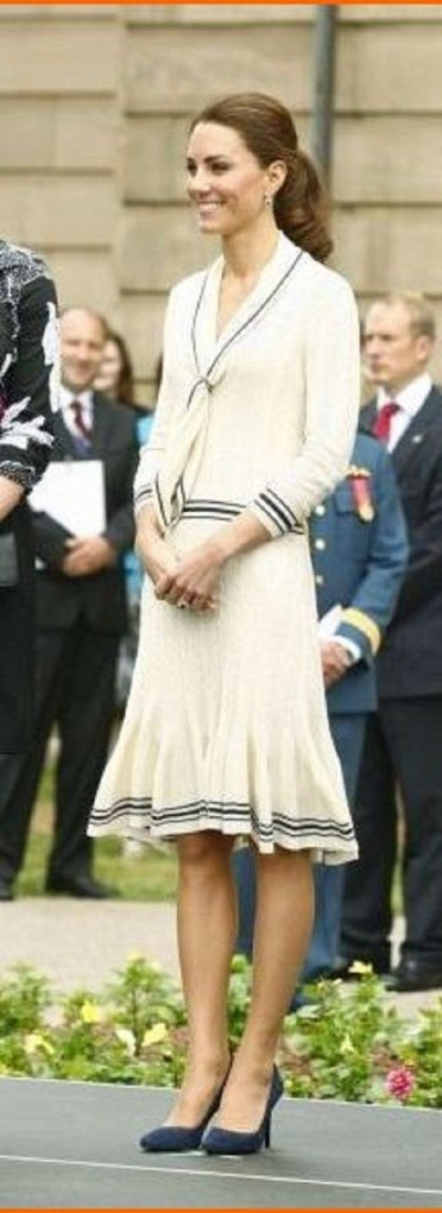 Kate Middleton wore the same cream knit Alexander McQueen dress, which she wore to Province House in Charlottetown, Prince Edward Island L in July 2011.
