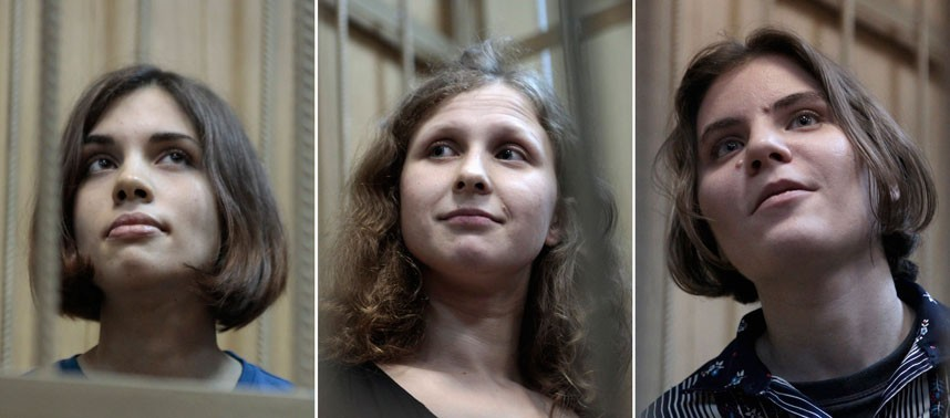 Pussy Riot members Nadezhda Tolokonnikova, Maria Alekhina and Yekaterina Samutsevich  are charged with hooliganism (Reuters)