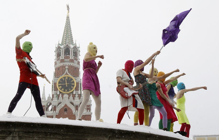 The three members of Pussy Riot are charged with hooliganism after singing an anti-Vladimir Putin song in a Russian church (Reuters)