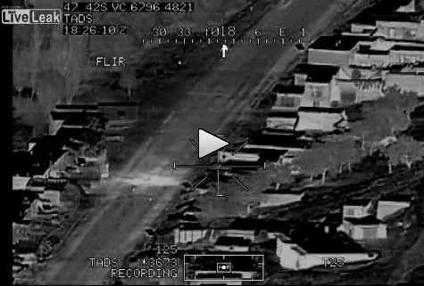 The missile hit was recorded on camera with the pilot happily singing away, LiveLeak.comy
