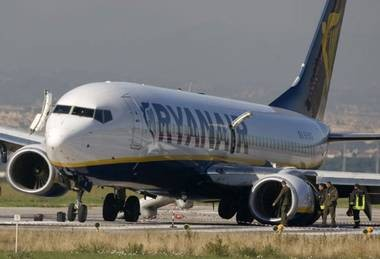 Ryanair are one of the companies who have agreed to include credit and debit card charges in overall price of tickets (Reuters)