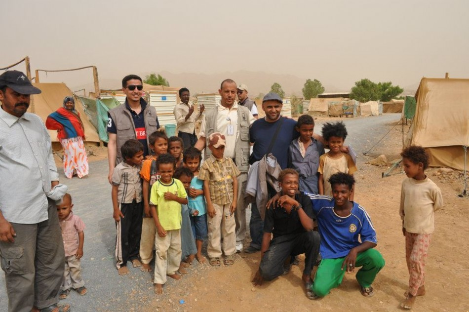 Habib Anam is to the left, wearing dark glasses and a dark T shirt. He is in the refugee camp in Aradh town, Hajjah City, north Yemen