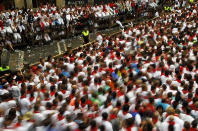 A crowd of runners wait for the start of the first running of the bulls of the San Fermin festival in Pamplona