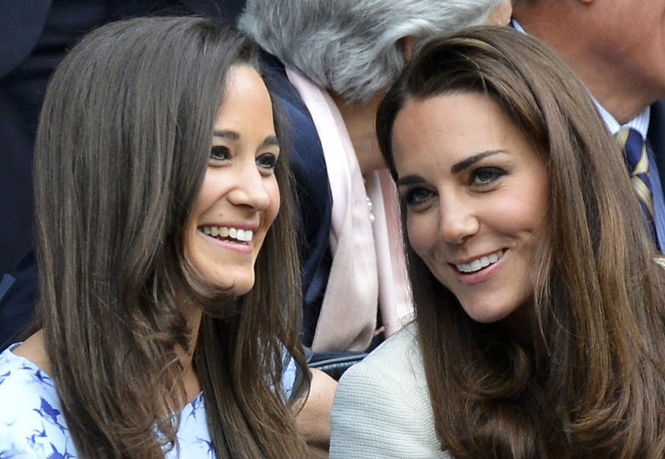 Britains Catherine, Duchess of Cambridge sits with her sister Pippa Middleton on Centre Court at the Wimbledon Tennis Championships in London