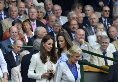 Britains Catherine, Duchess of Cambridge arrives with her sister Pippa Middleton on Centre Court at the Wimbledon Tennis Championships in London