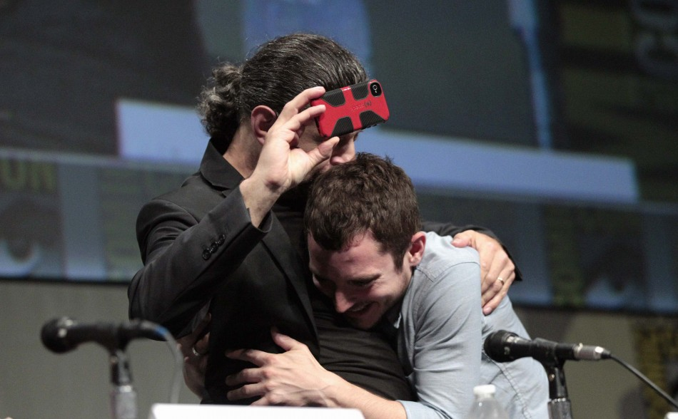 """Wood hugs Serkis at the beginning of a panel for """"The Hobbit: An Unexpected Journey"""" during Comic Con International convention in San Diego"""