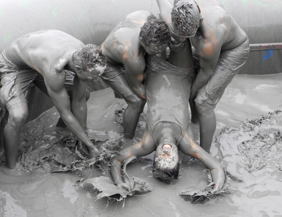 People play in the mud during the Boryeong Mud Festival at Daecheon beach in Boryeong