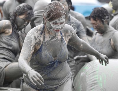 People play in mud during the Boryeong Mud Festival at Daecheon beach in Boryeong