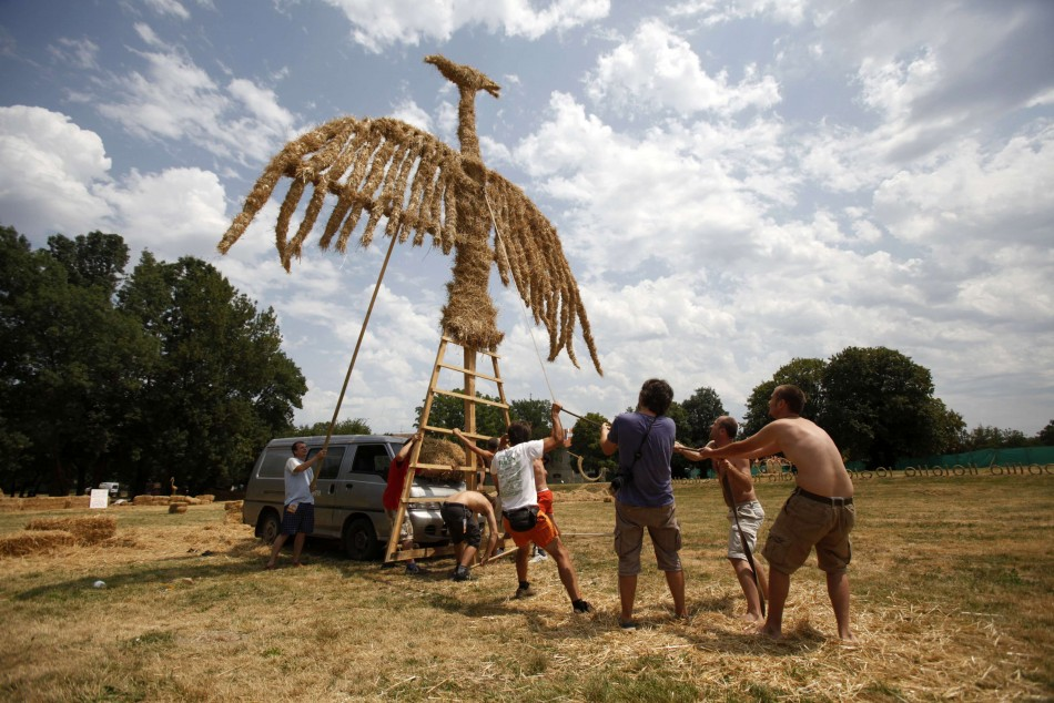 Artists set up a 10 meter high straw art installation of a phoenix during the 7th Straw - Land Art Festival in Osijek