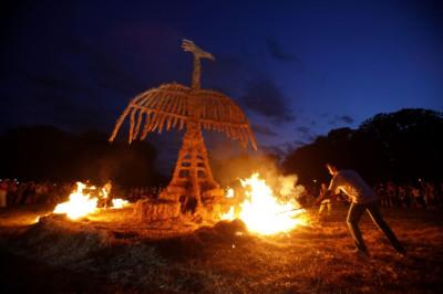 Artists burn a straw art installation during the 7th Straw - Land Art Festival in Osijek