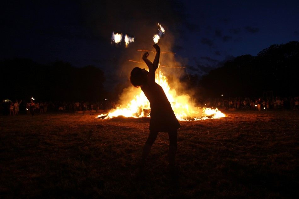 An artist plays with fire during the 7th Straw - Land Art Festival in Osijek