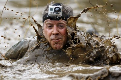 A competitor wears a camera on his head as he competes in the Tough Mudder at Mt. Snow in West Dover