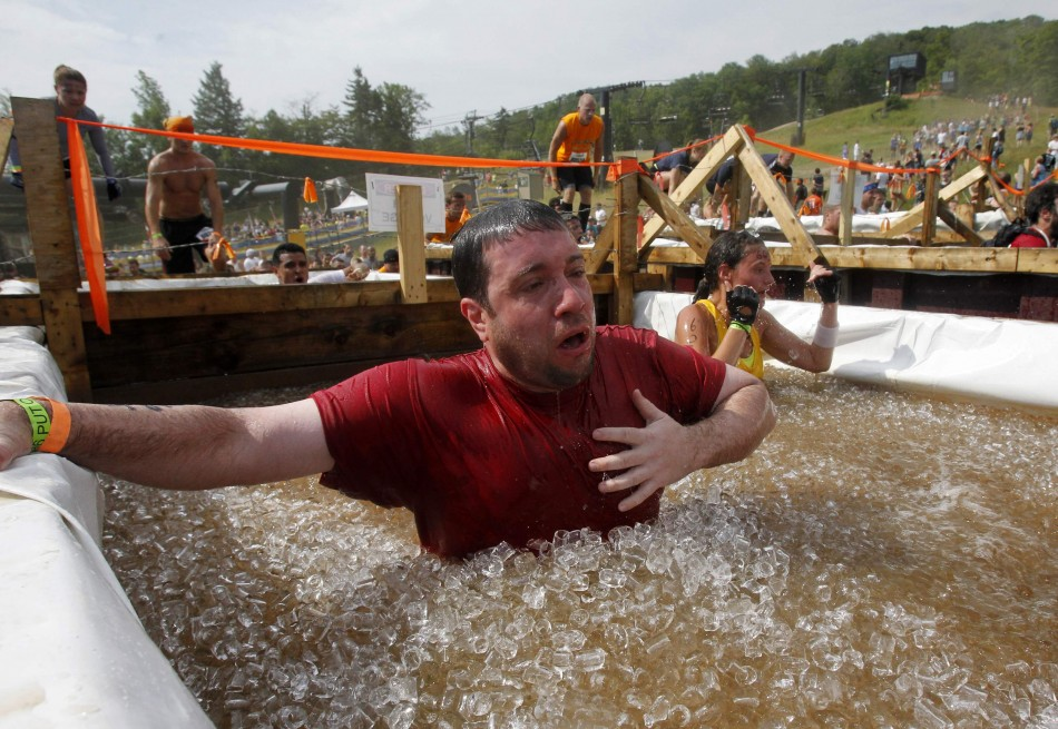 A competitor reacts after jumping into a vat of ice water during the Tough Mudder at Mt. Snow in West Dover