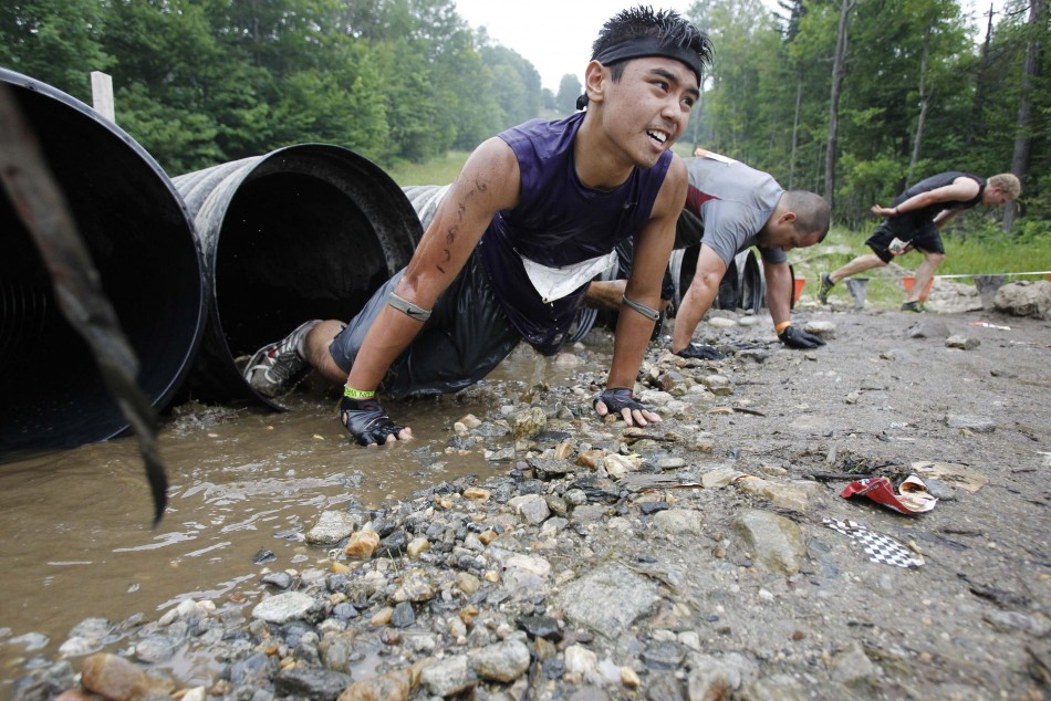 A competitor climbs out of a tube during the Tough Mudder at Mt. Snow in West Dover