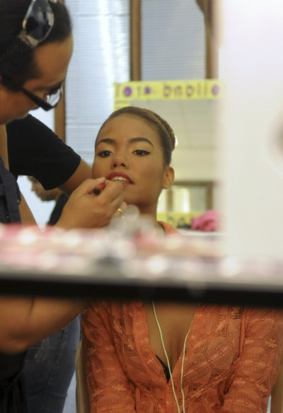 A model has her makeup applied backstage during Caribbean Fashion Week RD 2012 in Santo Domingo
