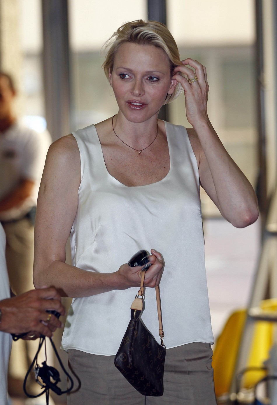 Princess Charlene of Monaco visits the South Africas swimming team for the London Olympics 2012 during a training session at Louis II stadium swimming pool in Monaco