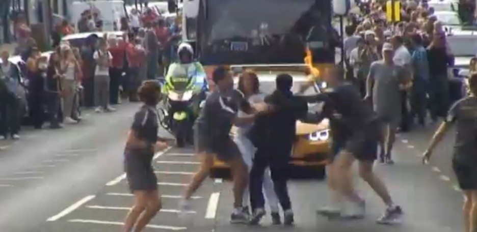 Officers tackle teenager as he tries to grab the Olympic torch in Gravesend (BBC)