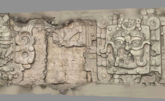 Screen shot of a video shows stucco masks, depicting several celestial beings, including the sun on the walls of the temple. (Photo: Brown University)