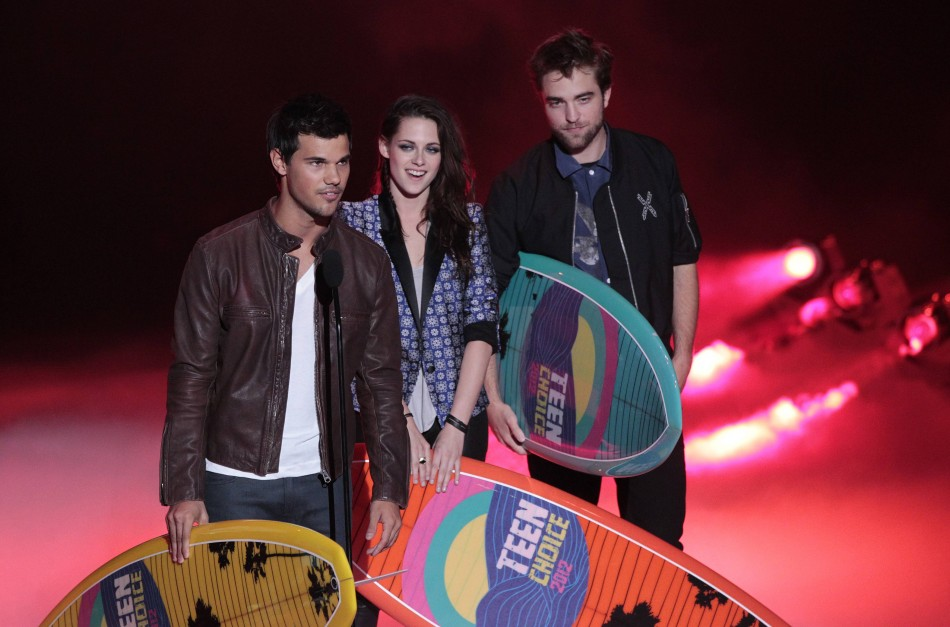 Lautner, Stewart, Pattinson accept the Ultimate Choice Award at the Teen Choice Awards at the Gibson amphitheater in Universal City