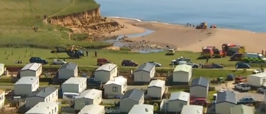 Emergency services have been called after a landslide at a beach near Burton Bradstock in Dorset (BBC)