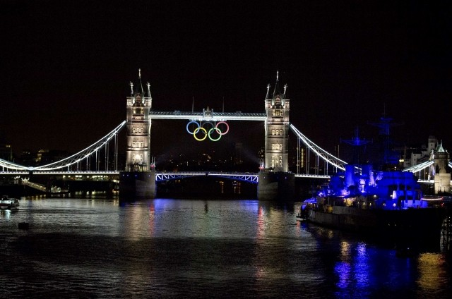 A view of the Tower Bridge is seen as it is lit up to celebrate the Olympics in London