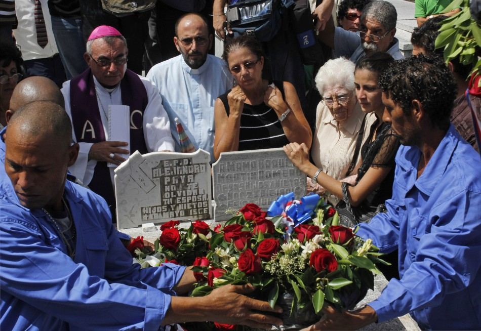 Ofelia Acevedo, wife of Oswaldo Paya, one of Cuba's best-known dissidents, mourns in Havana