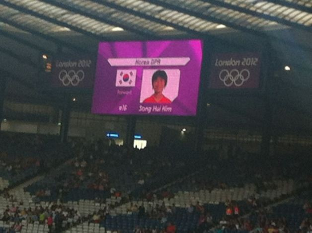 North Korea players were introduced on large screens alongside the South Korea flag of their bitter enemies.