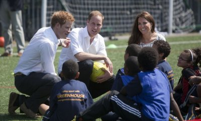 Prince Harry L, Prince William C, Kate Middleton R