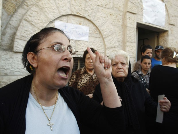 Reports of forced conversions have strained relations between a tiny Palestinian Christian community in the Hamas-run Gaza Strip and the Muslim majority.
