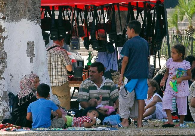 Syrian refugee family in Port Said Square in Algiers (Reuters)