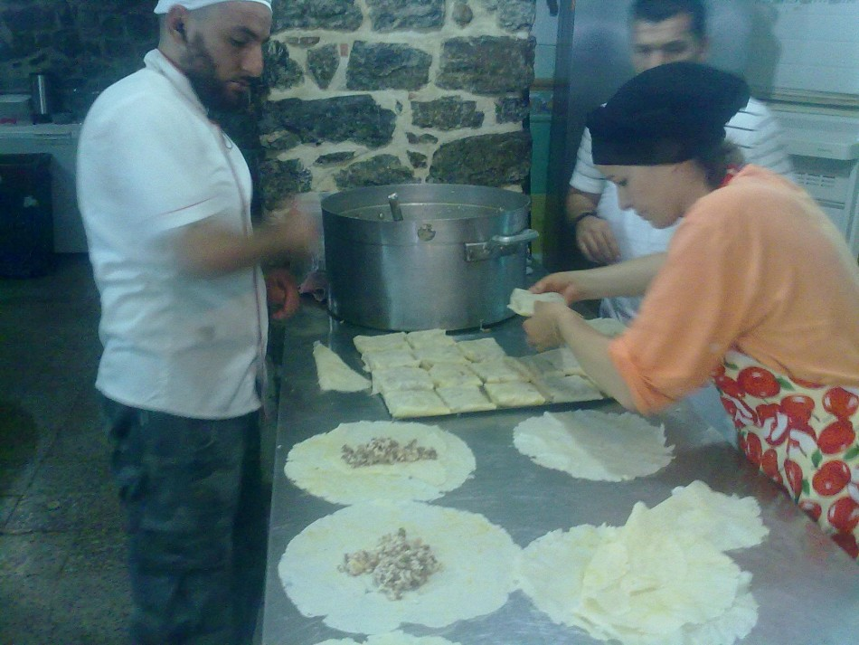 RDLD members and residents prepare meals for the Syrian refugees in Algeria staying in Port Said Square in Algiers