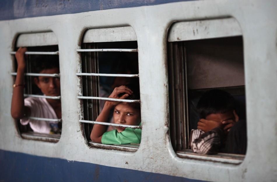 26 schoolchildren killed as train rams bus