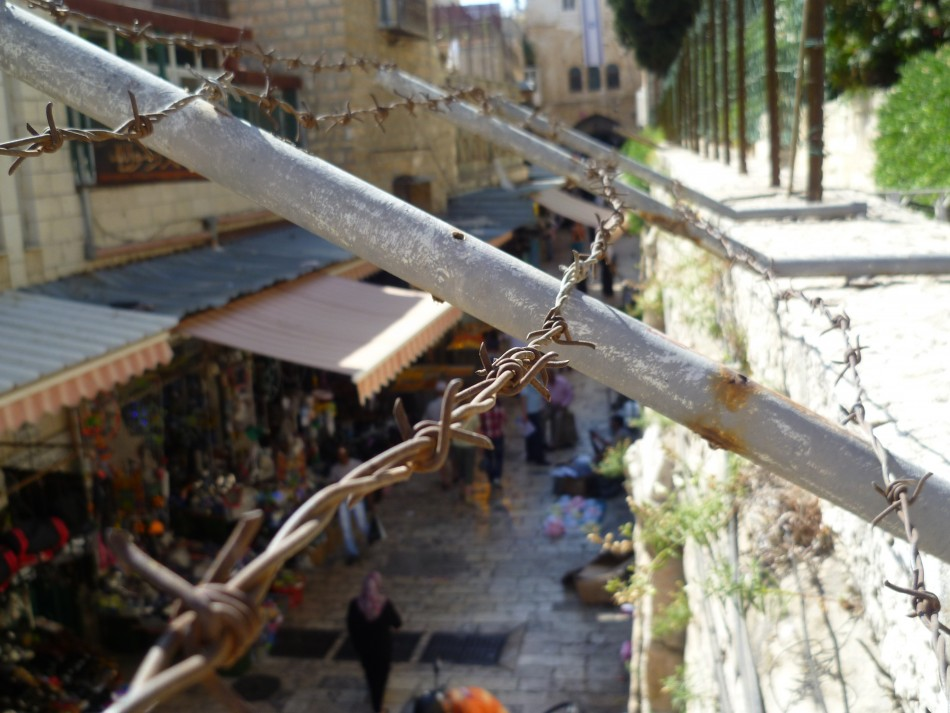 A woman walks in a street of the Old City, Jerusalem