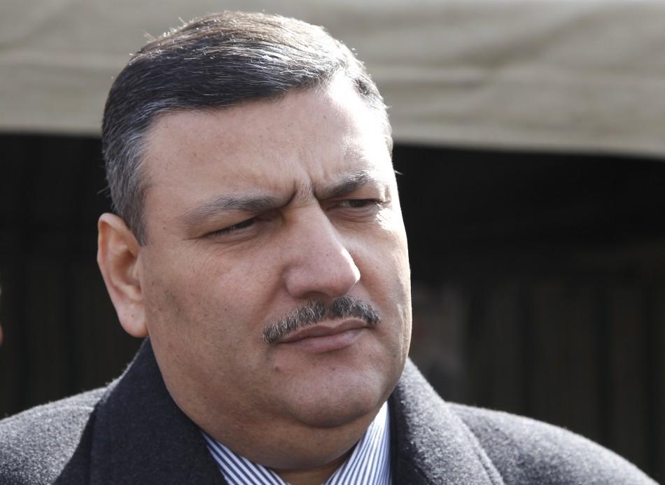 File photo shows governor of al-Qunatara city and former agriculture minister Riyad Hijab in al-Qunatara, Reuters