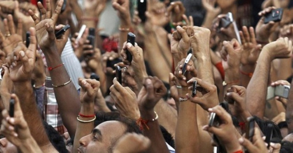 Indians using their mobile phone for taking pictures.