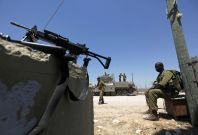Israeli soldiers guard the border with Egypt at the Kerem Shalom crossing, Reuters